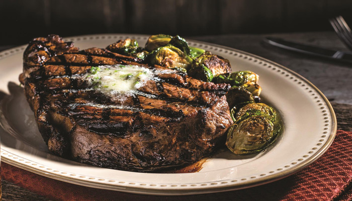 Grilled Ribeye Steak with Herbed Steak Butter