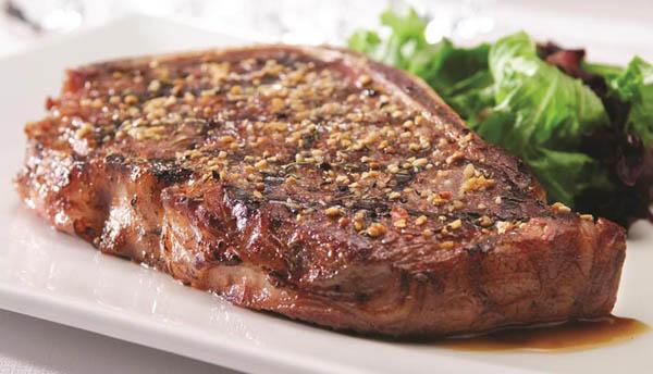 Strip Steaks with Three-Pepper Rub